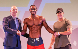 INBF Promoter and WNBF Pro John Heart awarding Overall Physiqe Champion Bryan Irving at the 2016 INBF LA